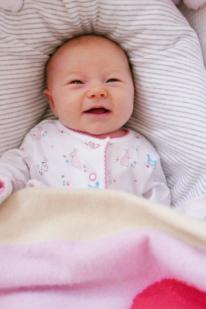 4 week old baby smiling